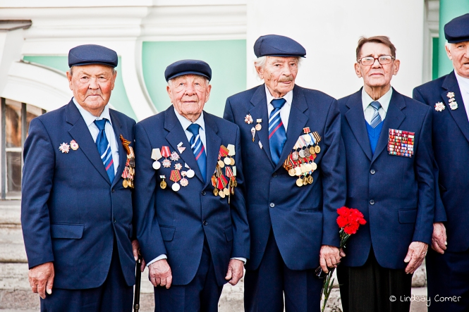 A candid shot of veterans posing for the media on Victory Day; Saint Petersburg, Russia.