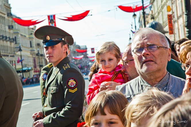 Little girl with her father, waiting for the Victory Day Parade to begin in Saint Petersburg, Russia.