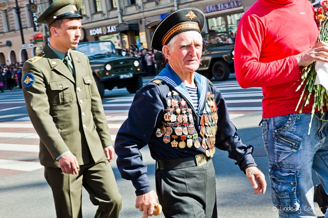 A well-decorated veteran marching in the Victory Day Parade, Saint Petersburg, Russia.