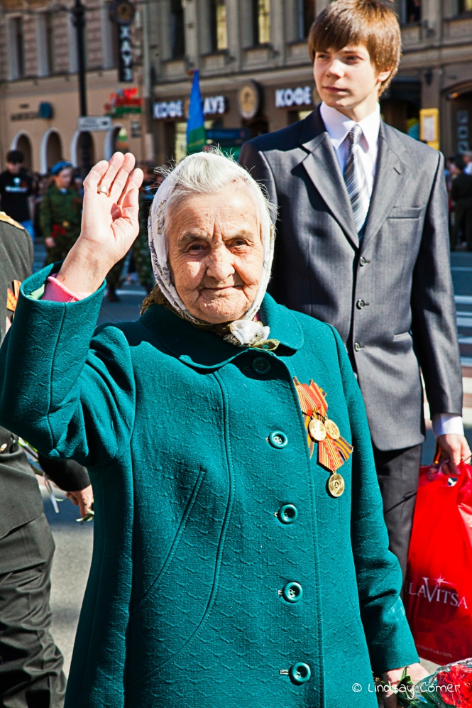 A babushka marching in the Victory Day Parade in Saint Petersburg, Russia.