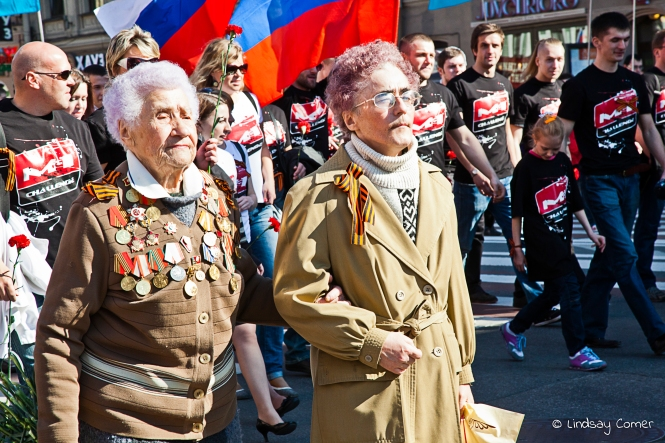 Two Russian woman marching in the Victory Day Parade; Saint Petersburg, Russia.