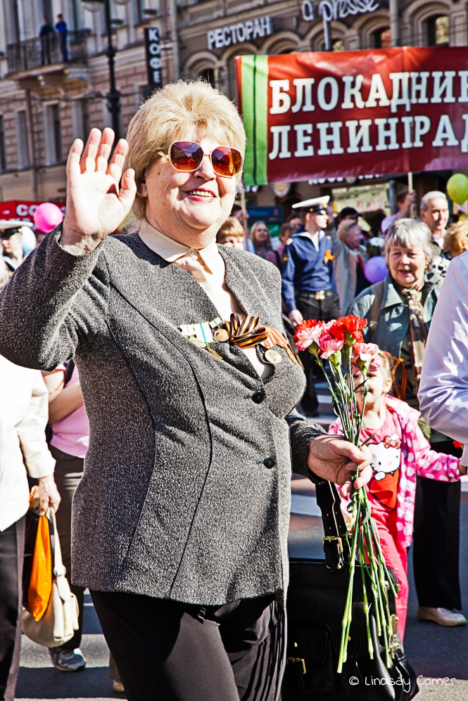 A Russian woman marching in the Victory Day Parade, Saint Petersburg, Russia.