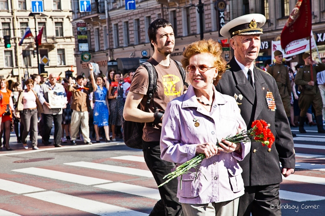 "A Russian veteran and his ""wife"" marching in the Victory Day Parade, Saint Petersburg, Russia."