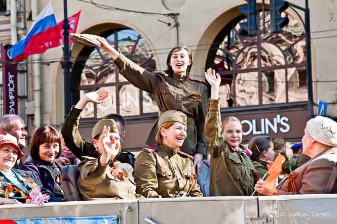 Юююююррррррааааа! Young woman waving to the crowd in the Victory Day Parade; Saint Petersburg, Russia.