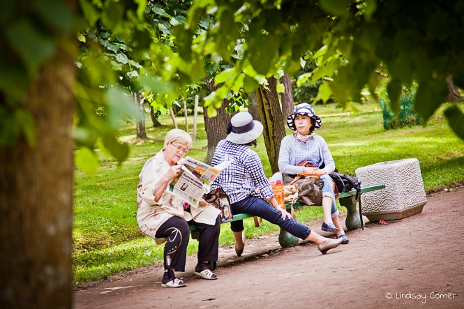 Women sitting on a bench in the park at Peterhof, Saint Petersburg, Russia.
