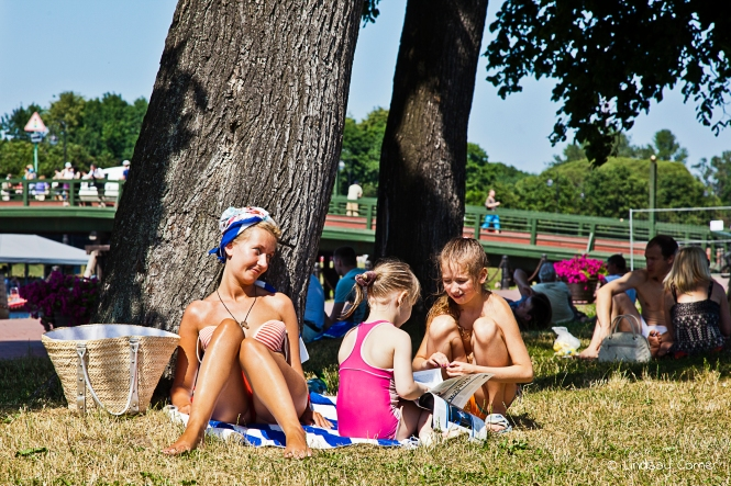 Having girl-talk; summer months, Zayachiy Ostrov, Saint Petersburg, Russia.