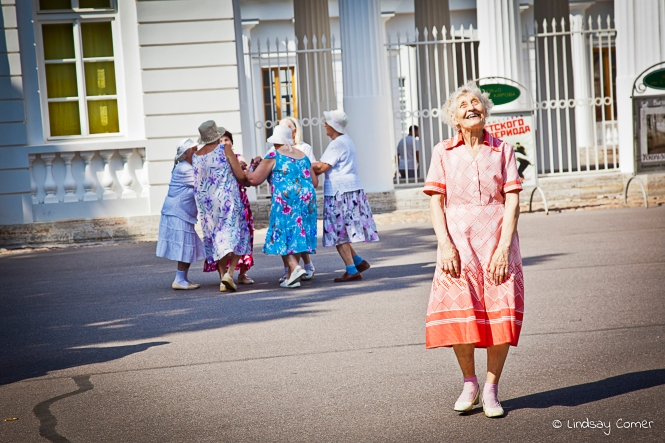 The dancing babushka joyfully laughing after she finishes her dance; Yelagin Ostrov, Saint Petersburg, Russia.