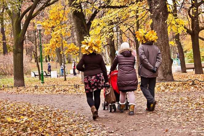 Walking in Tavricheskiy in autumn, wearing leaf crowns; Saint Petersburg, Russia.