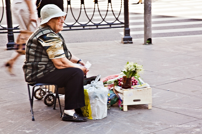 the woman selling flowers on Vladimirskiy Prospekt.