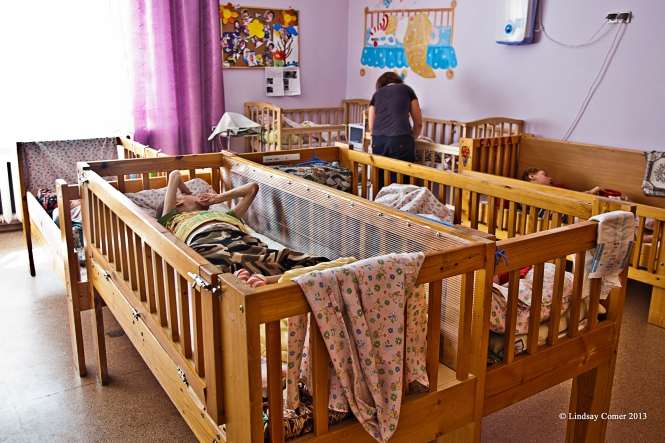 inside the orphanage. the cribs where many children spend a good part of their days.