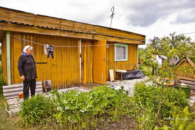 Our dacha and the babuska (standing to the left).