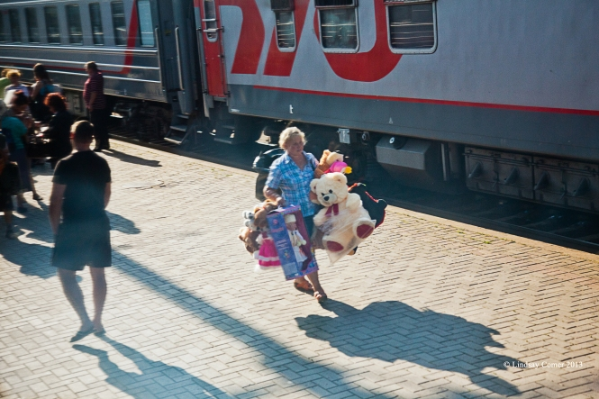 a woman selling stuffed animals at the long train stop (again, Bryansk or Suzemka).