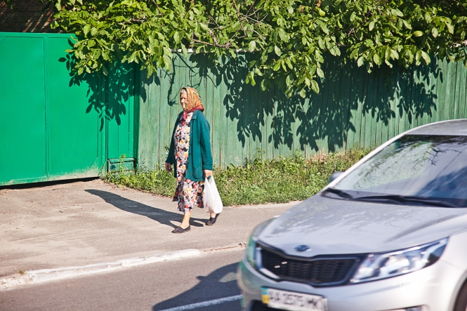 babushka walking on the sidewalk; on the bus ride home from Chernobyl.