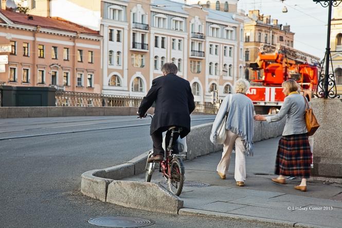 an older man riding his bicycle.