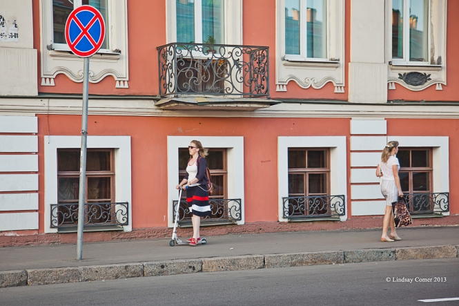 young woman on a scooter.