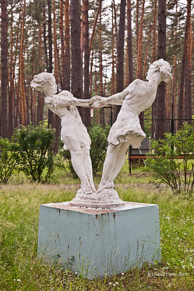 a statue from Soviet times of two children playing - at the camp grounds.