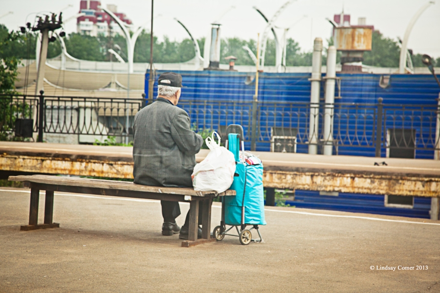 a man waiting on a train platform (while on my way to Peterhof).