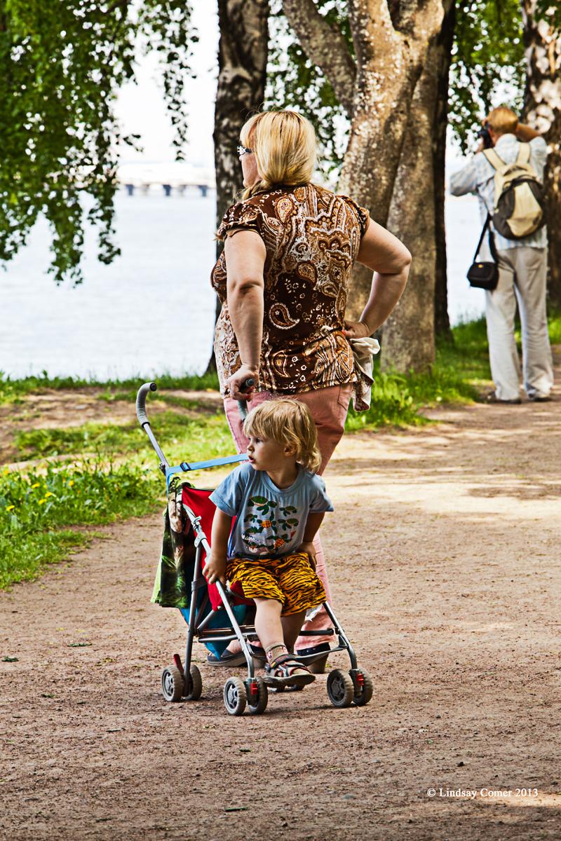a little boy in his stroller.