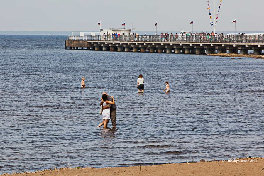 a couple embracing in the Baltic Sea.