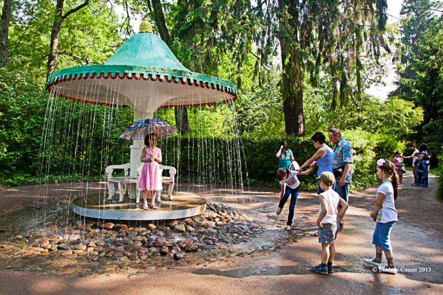 children playing near a fountain.
